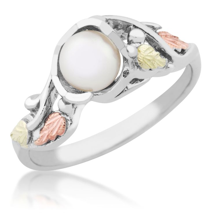 Accent your ensemble with this gorgeous sterling silver tri-color pearl ring. 12 karat Black Hills yellow gold and rose gold plate the delicate leaf accents, complementing the swirling sterling silver