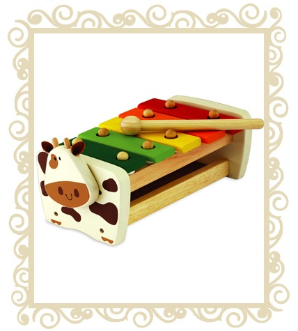 $34.95 - I'm Cow Xylophone Bench will be a hit with every musical child! Produced from sustainable rubber wood and finished with non toxic paint. 19+Mths