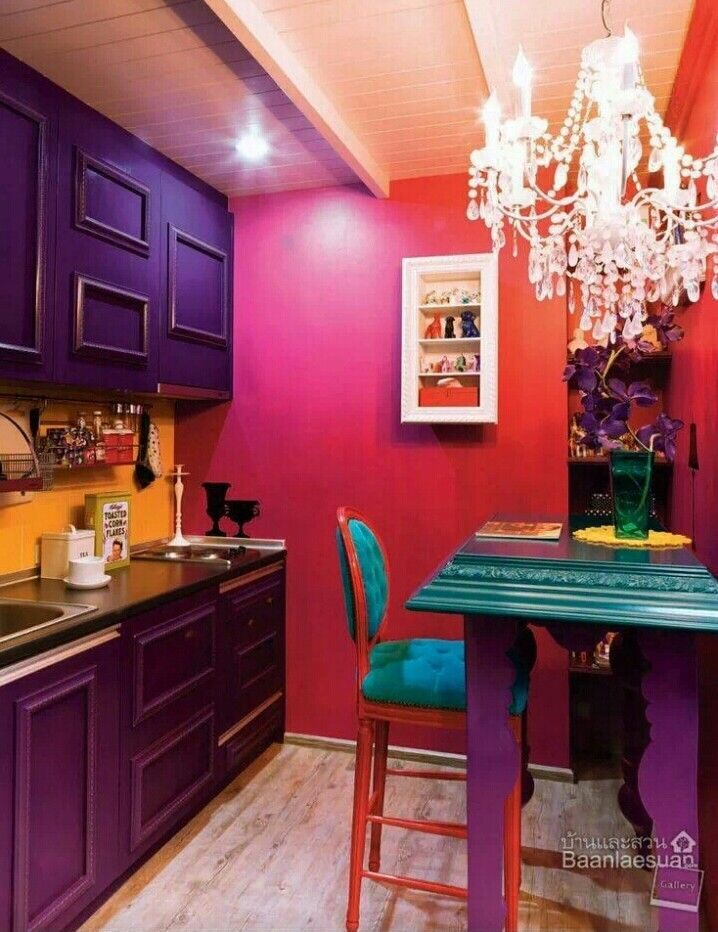 Purple cabinets in a tiny glam kitchen, The chandelier is a step too far, though.