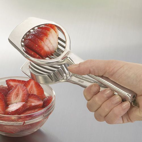 Use an egg slicer for instant and perfect strawberry slices ... why didn't i think of that