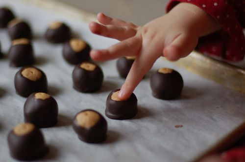 Recipe for buckeyes (peanut butter and chocolate) from Molly Hays of Remedial Eating.