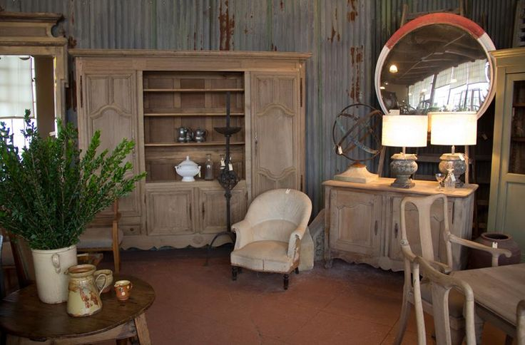 Vintage convex railway mirror, antique bleached oak French dresser, antique French tub chair.