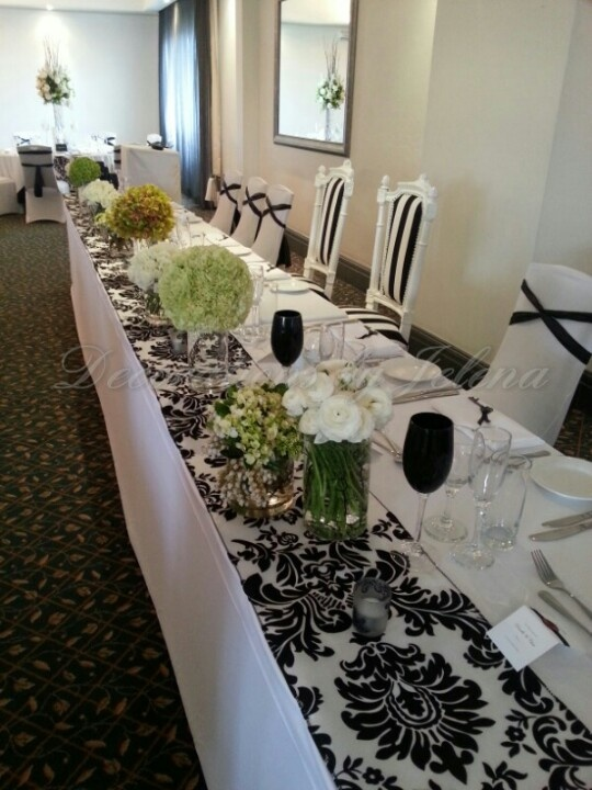 Modern black and white with a touch of green wedding reception decor