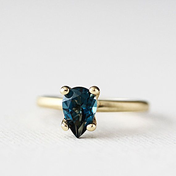 LOVE this ring! It's so different. 14k gold london blue topaz ring by AndreaBonelliJewelry on Etsy, $488.00