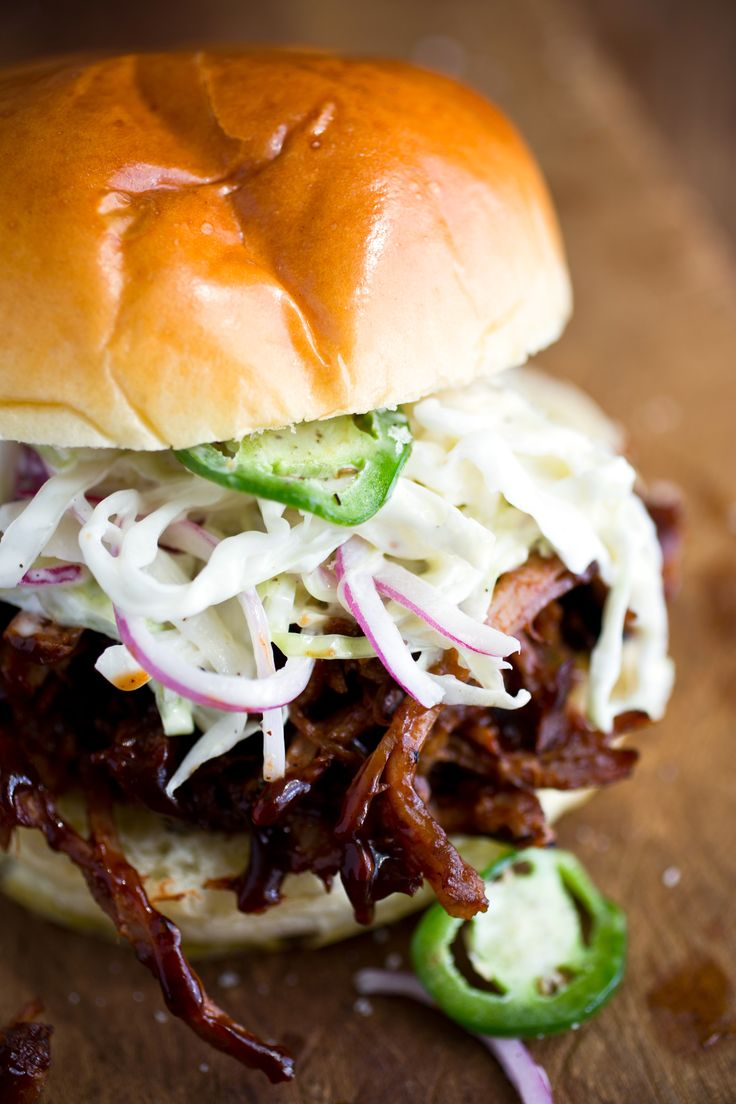 Recipe: Pulled pork sandwiches with spicy jalapeño slaw || Photo: Andrew Scrivani for The New York TimesPulled Pork Slaw Sandwich, Pulled Pork Sandwiches, Slow Cooker Recipes, 10 Slow, Pulled Pork Burger, Pork Sandwich Recipes, Brioche Bun Pulled Pork, Actually Slow, Stacked Pulled Pork Sandwich