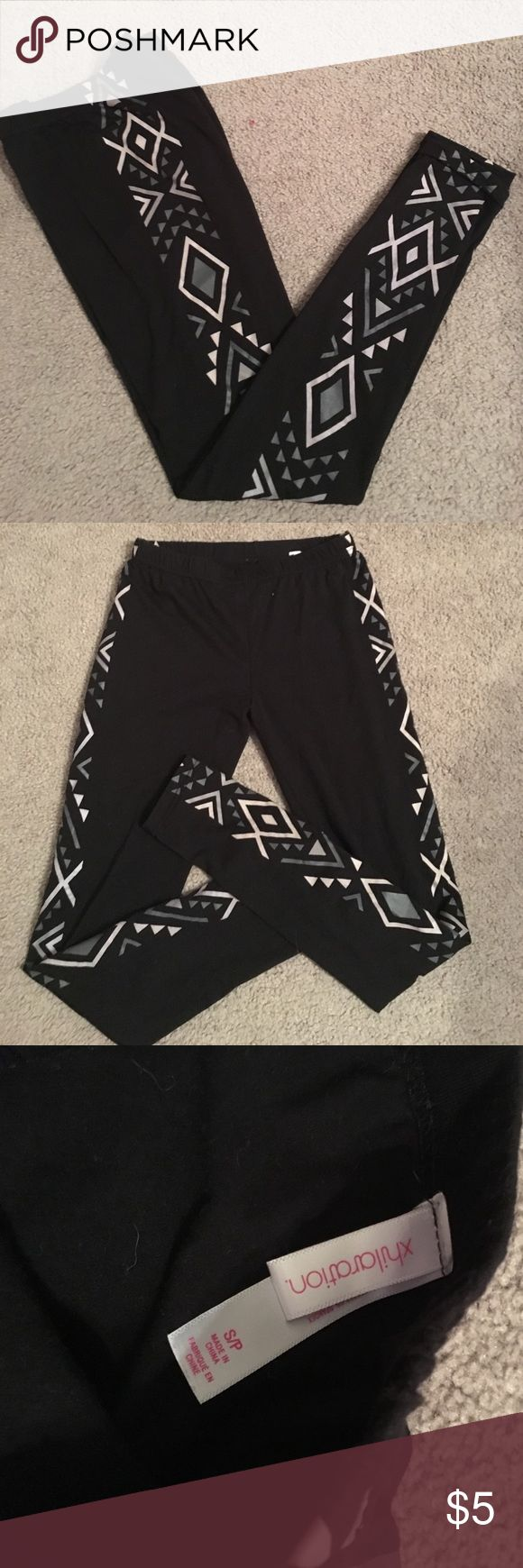 Aztec print leggings Black leggings with Aztec design on each side. Size small. In excellent condition. Xhilaration Pants Leggings