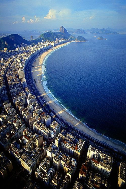 Copacabana Beach, Rio de Janeiro - It was completed in 1970 and has used a black and white Portuguese pavement design since its origin in the 1930s: a geometric wave. The Copacabana promenade was designed by Roberto Burle Marx