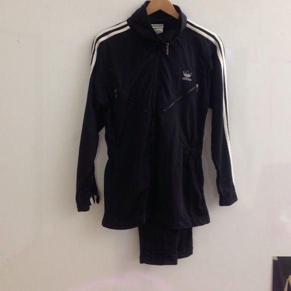 Vintage black Adidas tracksuit with 3/4 jacket. Extremely rare Adidas tracksuit with 3/4 length jacket with elastic cinched waist. Great condition!  Never seen one like it! Adidas Tops Sweatshirts & Hoodies