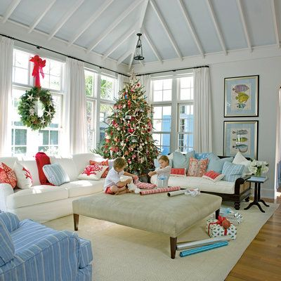 Give your traditional decor the holiday treatment. Update everyday interiors with bright and cozy blankets, throw pillows in vibrant holiday hues and trees, and greenery studded with delicate starfish ornaments.