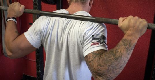 """Editor's note: This is a guest post from powerlifter and strongman Matt Reynolds. If you've lifted weights for any significant amount of time, the odds are that you have struggled with bicep tendonitis. Maybe you didn't know it was bicep tendonitis, but it basically felt like a dull, painful ache on the anterior (front) part of your forearm where it meets your bicep tendon (see image below).  """"X"""" marks the spot where you'll feel the dull, aching pain from distal (lower) bicep tendonitis…"""