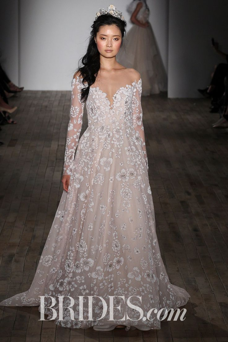 """""""Stevie"""" sandwashed orchid wedding dress in a soft ball gown silhouette with caviar beading, an off-the-shoulder neckline, long illusion sleeves, a low scoop back, and a full floral skirt, by Hayley Paige"""