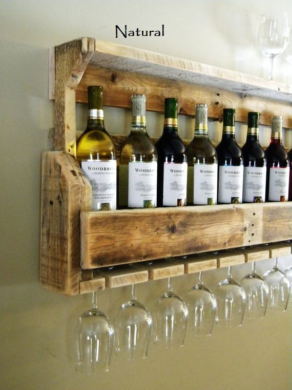Reclaimed pallet wood wine rack. Rack is handmade one piece at a time. Each piece of wood used is hand selected for its unique character and grain style. All wine racks are slightly sanded to prevent large slivers and snagging rough wood. Wine and glasses not included..  STANDARD WINE RACK SIZE: 37 inches long 18 tall  6 inches deep -Dimensions are approximately   PLEASE NOTE: The photos provide a representation of what will be made for you upon order. Slight variations are to be expected…
