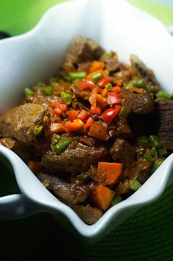 Zimbabwean beef stew (nyama) is a simple dish typically served with sadza, a…