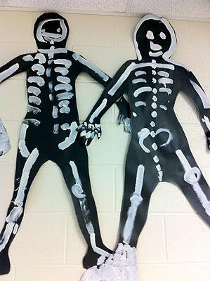 Skeletons: Lessons About Bones - paint on black butcher paper