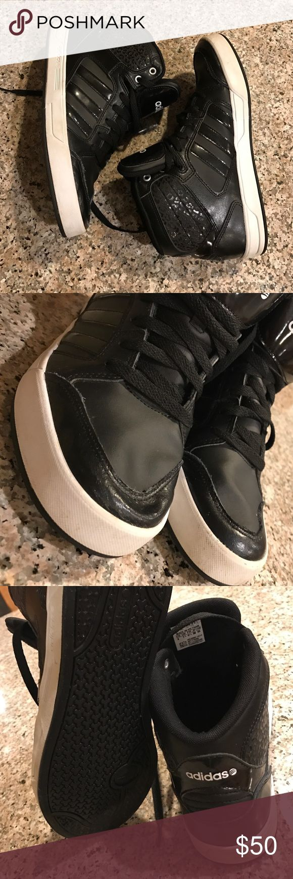 Adidas Neo Raleigh high tops Women's size 9 black Sporty high top basketball style shoe great for street style with jeans, black leggings, or bodycon dress! Overlay accent, white logo, leather upper, rubber sole. Women's size 9 Adidas Shoes Athletic Shoes