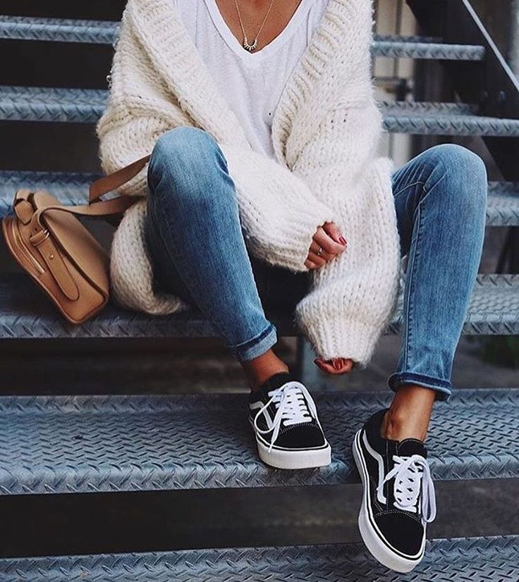 Pair blue jeans, a neutral sweater, a white tee and sneakers and you are good to go in a casual but fashionable outfit