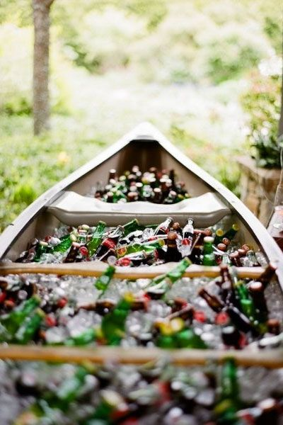 Put your drinks on display in an ice-filled canoe at your rustic summer wedding   Melissa Schollaert Photography