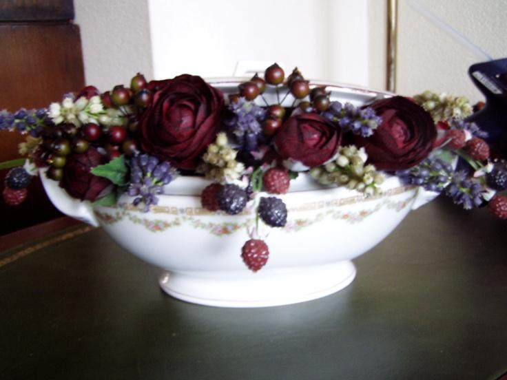 silk flowers in antique bowl