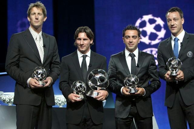 2009: JOHN TERRY (far right) collects his award after being voted UEFA's Defender of the Year, on stage alongside Edwin van Der Sar, Lionel Messi and Xavi Hernandez...