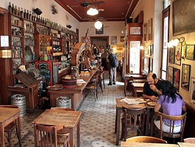 The San Telmo cafe where Prince Vittorio and Emily meet for morning croissants and discuss their evening tango plan.