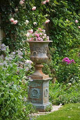 By placing an insubstantial urn on a pedestal you can give it more importance thus creating a strong focal point.