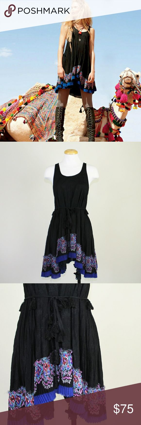 NWOT Free People FP ONE Tiered Tassel Dress Gorgeous boho tiered mini dress from Free People FP ONE in like new condition. Features raw, asymmetrical, pleated, floral paisley hem with tassel belt. Absolutely beautiful dress! Perfect for festivals!  Please let me know if you have questions or need more pictures. I will consider all reasonable offers, but no trades, please. Free People Dresses Mini