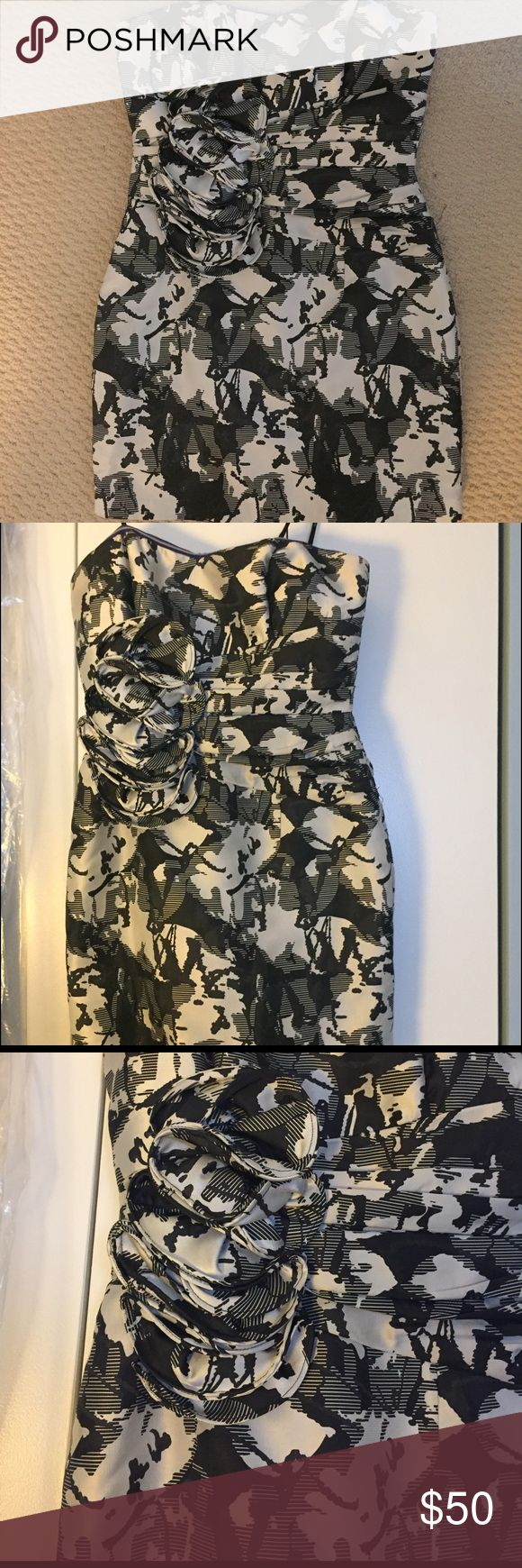 Black and White abstract mini dress 100% Polyester Black and White Abstract Mini Dress with floral design. Ark & Co Dresses Mini