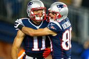 Julian Edelman #11 and Danny Amendola #80 of the New England Patriots react after Edelman scored a touchdown during the second quarter against the Denver Broncos at Gillette Stadium on November 2, 2014 in Foxboro, Massachusetts.