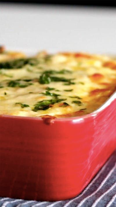 Recipe with video instructions: How to make an Easy Baked Rice & Cheese Casserole. Ingredients: 2 yolks, 1 3/4 cups cream (25 percent fat content), 5.2 ounces shredded mozzarella, 7 ounces minced ham, 1 grated carrot, 1 minced onion, 2 minced chive stalks, Salt, Nutmeg, 2 cups cooked white rice, Grated parmesan cheese, Minced parsley