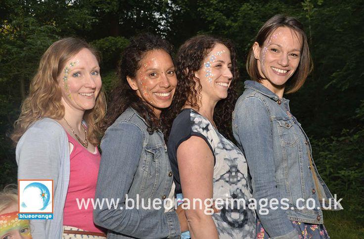 Blue Orange Images facepainting Watford, Big girls celebrating Birthday at Wendover Woods, Chilterns, Buckinghamshire with flower designs on cheeks