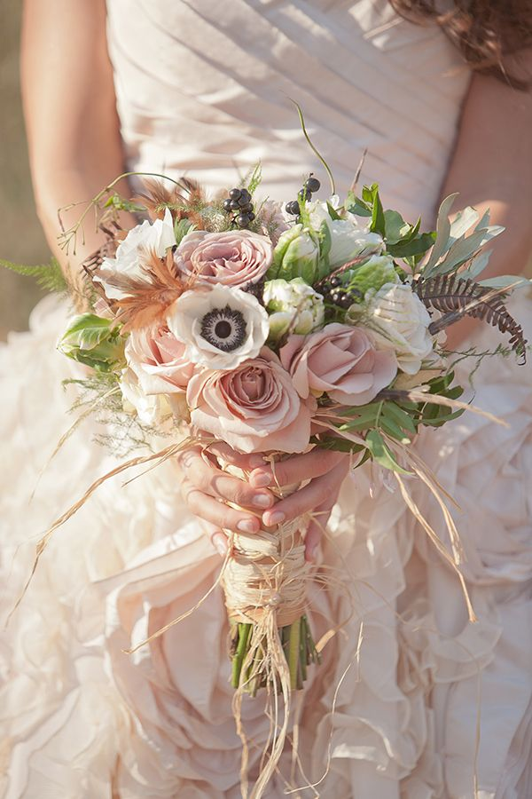 Anemones, roses, and foliage wrapped with raffia | Photo by Millie Batista #anemones #roses #foliage #bouquet