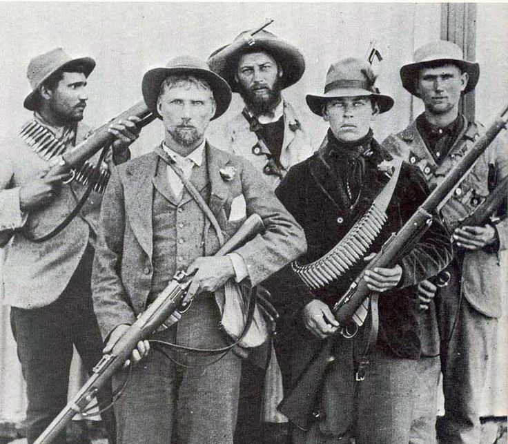 Classic pose of a young Boer Commandos that demonstrates = for all men of all nations throughout history - the dogged resolve of men to resist invaders of their homeland. No hint of a smile or surrender, each had probably lost a sister, mother, wife, daughter or granny in the concentration camps; or more than one. They show their success in being able to liberate British guns and ammo to turn against their attackers.