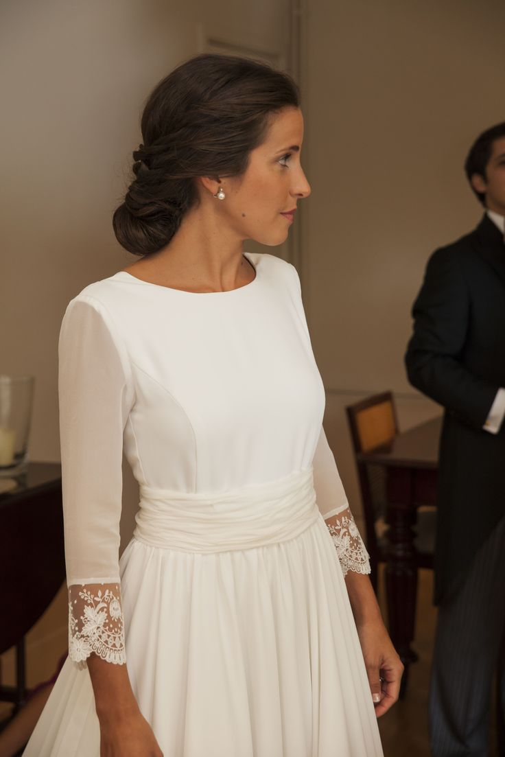 marta martí long-sleeve wedding dress with sheer lace cuff sleeves and v-neck back