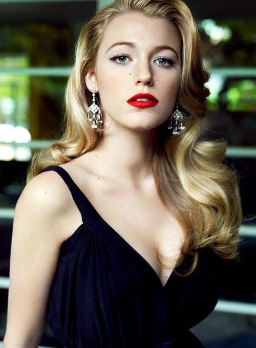 Blake Lively, channelling old Hollywood glamour. Gorgeous black draped gown revealing immaculate décolletage. Stark red lips against beautiful fair skin - always a win.