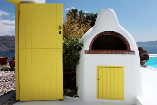 Built-Traditional-Stove-White-Yellow-Exterior-Sea View-VillaForRent-Oia-Santorini
