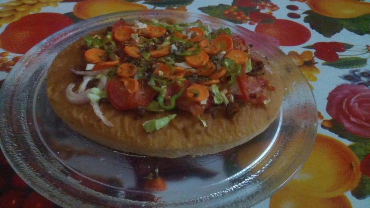 Home-Made pizza with minimum requirements ..... Prepared in micro-oven .... 15-20 mins. .....