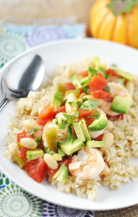 Fresh, light white bean and shrimp stew, topped with avocado salad.