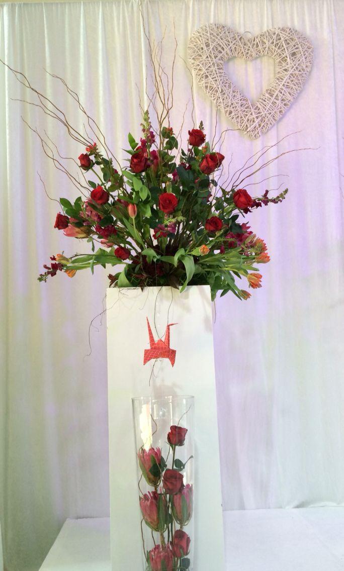 Origami bird in floral arrangement