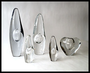 "Glassware by Finnish designer Timo Sarpaneva. The 4 on the left as his ""Orkidea"" [orchid] vases."