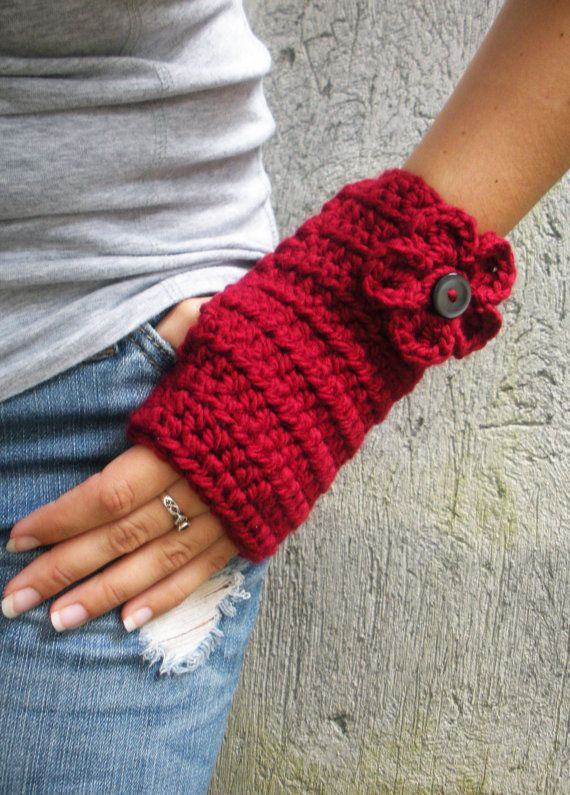 """Crocheted hand warmers. These are super easy and fast to make."" I want to make these long and white without the flower and button."