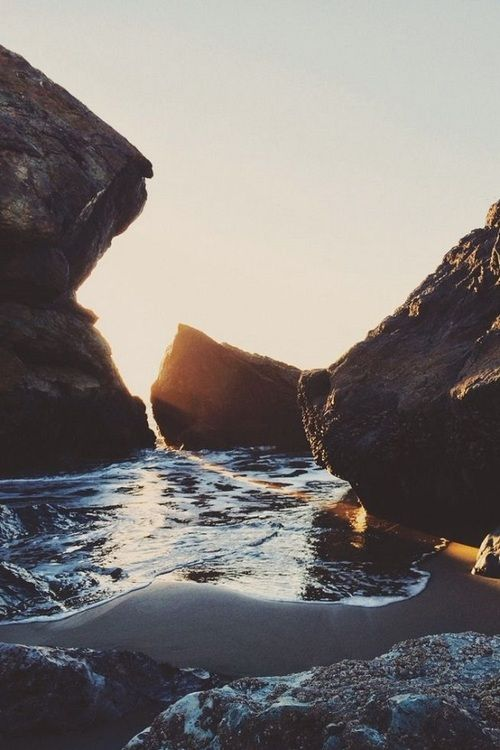 Sunset through rocks