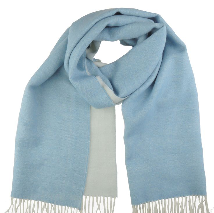 Super soft and warm scarf made of 100% baby Alpaca in blue and white. A real basic to enjoy for many years also available in other colours.