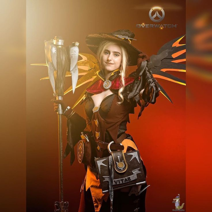 HEROES NEVER DIE  . . So it must still be Halloween somewhere?  . . Always so impressed with @snaphappyian s work and love getting the chance to shoot with him - even if that means two minutes at a convention!  . #overwatch #halloween #mercy #witchmercy #photography #sexy #witch #crafting #cosplay #cosplayer #cosplaying #costuming #cosplaygirl #gaming #overwatchmercy #healer #pax #pax2017 #playstation #ps3 #mercycosplay