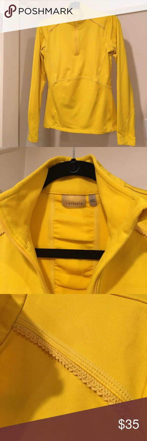 Athleta bright yellow poly/spandex 1/4 zip. Size S This is a wonderful bright fun yellow Athleta 1/4 zip heavyweight athletic shirt. Comes with fun detail trim, and ruching on back with back zipper pocket, reflective trim and thumb holes. Great for early morning workouts or runs to cut the chill. Great condition. Athleta Tops Sweatshirts & Hoodies