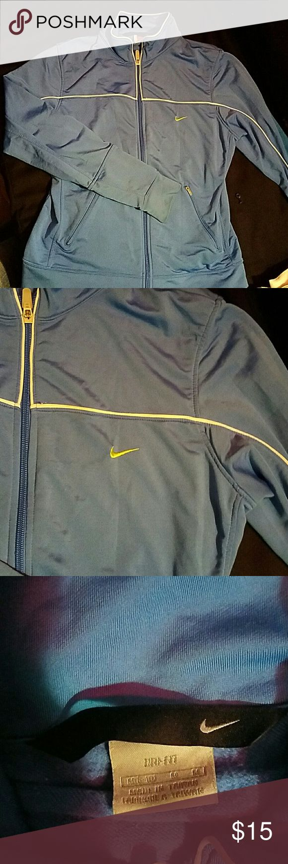 Nike zip up running long sleeved shirt Nike brand.  Thin dri-lite material.  Baby Blue in color with white piping and a neon yellow swoosh.  Size medium womens. Nike Tops Tees - Long Sleeve