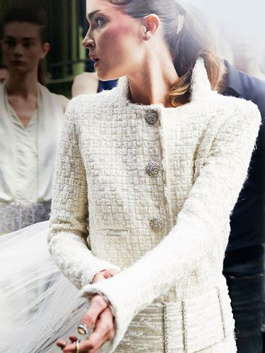 Erin Wasson closed the Chanel Haute Couture show in an elegant button-down coatdress with a silk tulle train.
