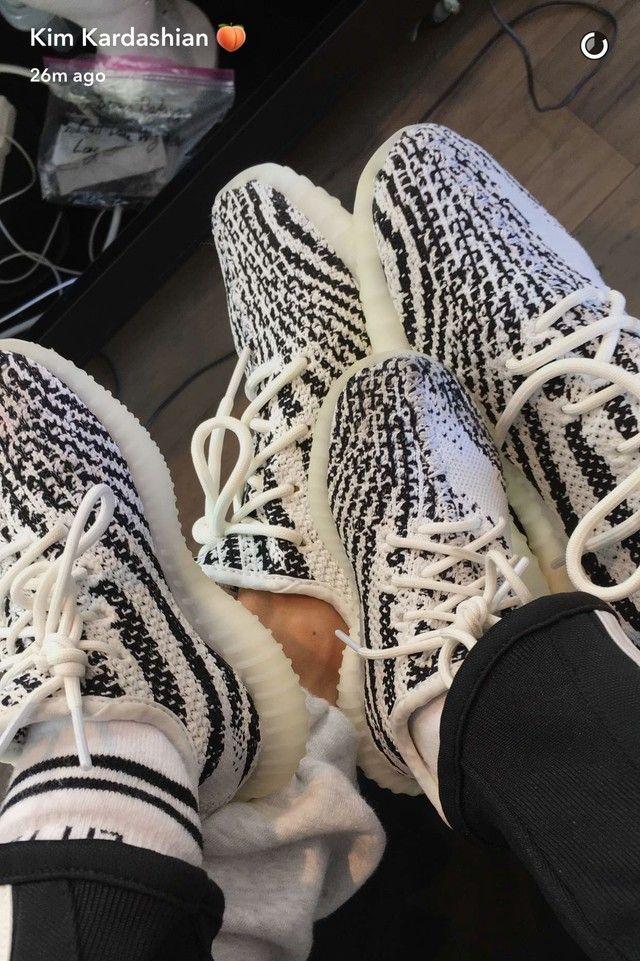 Kim Kardashian wearing Adidas Yeezy Boost 350 V2 zebra feedproxy.google. fbc29da947
