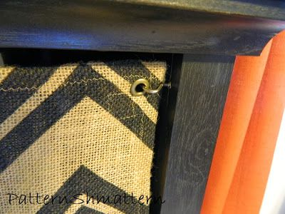 Baby proofing bookshelves with fabric.