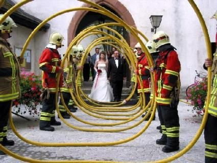 What an awesome idea for a firefighters wedding.