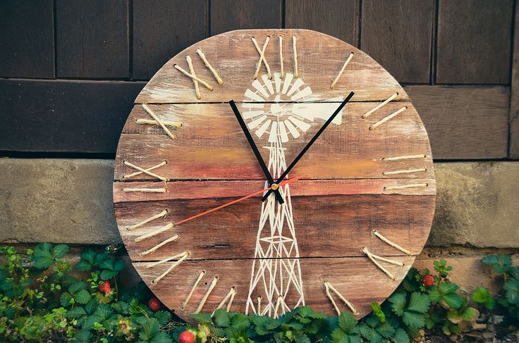Windmill clock made from pallet wood and pulled out my best painting skills :)